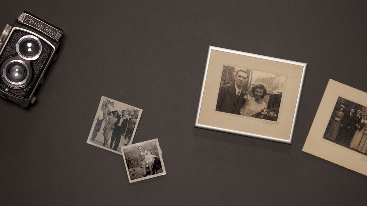 Old family photos framed next to Rolleicord camera