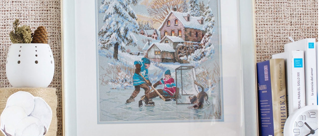 Framed cross stitch - winter sports